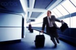 Businessman Running to Catch a Flight --- Image by © Larry Williams/CORBIS