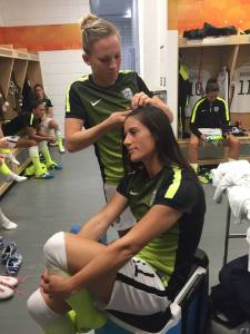 Amy Rodriguez and Ali Krieger preparing for a game